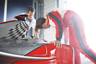 Racing team working on car - CAIF01761