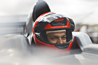 Racer sitting in car on track - CAIF01770