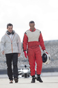 Racer and manager walking on track - CAIF01785