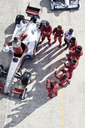 Racing team surrounding racer on track - CAIF01788