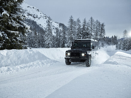 Austria, Tyrol, Stubai Valley, off-road vehicle in winter - CVF00179
