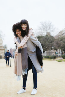 Spain, Barcelona, portrait of two happy women in city park - EBSF02175