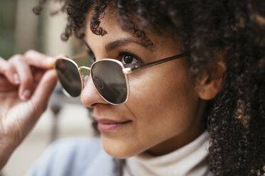 Portrait of smiling woman wearing sunglasses - EBSF02184