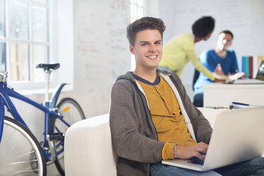 Businessman using computer in office - CAIF01848