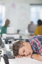 Businessman sleeping at desk - CAIF01860
