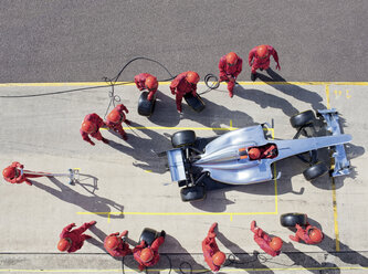 Racing team working at pit stop - CAIF01977