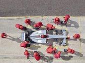 Racing team working at pit stop - CAIF02004