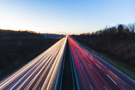 Germany, Baden-Wuerttemberg, Autobahn A8 near Wendlingen in the evening, light trails - WDF04475