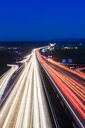 Germany, Baden-Wuerttemberg, Autobahn A8 near Wendlingen in the evening, light trails - WDF04478