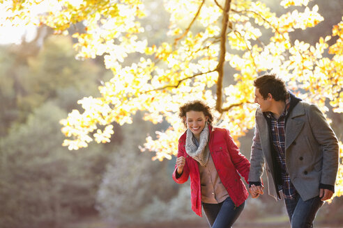 Couple walking together in park - CAIF02056