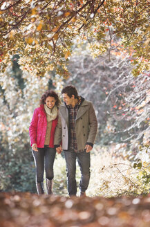 Couple walking together in park - CAIF02062