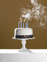 Extinguished birthday candles on birthday cake - CAIF02107