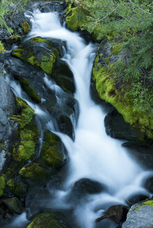 River rushing over rocky hillside - CAIF02134