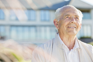 Smiling older man standing outdoors - CAIF02176