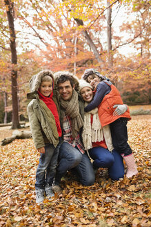 Family smiling together in park - CAIF02362