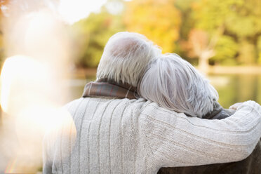 Older couple hugging in park - CAIF02377
