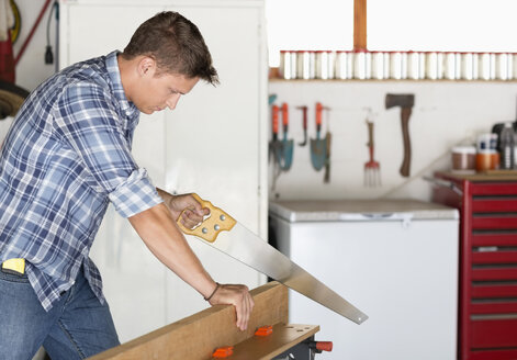 Man working in workshop - CAIF02404