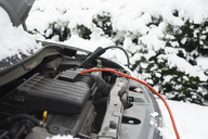 Wires on car battery in snow - CAIF02443