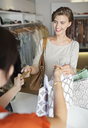 Woman shopping in clothes store - CAIF02467