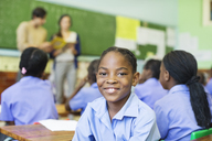 Student smiling in class - CAIF02479