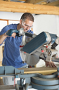 Man working in workshop - CAIF02529