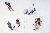Business people in busy office hallway - CAIF02574