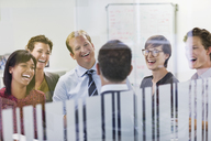 Business people laughing in meeting - CAIF02577