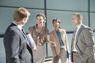 Business people talking on city street - CAIF02598