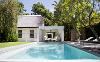 Lawn chairs and swimming pool in backyard - CAIF02622