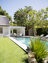 Lawn chairs and swimming pool in backyard - CAIF02631