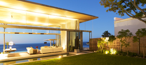 Illuminated modern patio at twilight - CAIF02733