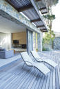 Lawn chairs on wooden patio - CAIF02745