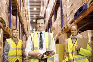 Workers standing in warehouse - CAIF02778