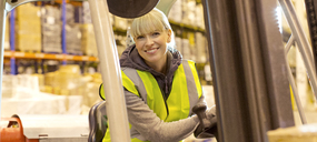 Worker operating forklift in warehouse - CAIF02784