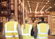 Workers talking in warehouse - CAIF02790