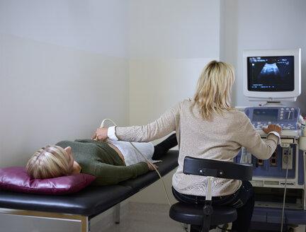 Woman in hospital getting sonogram - CVF00191