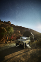 Africa, Namibia, Spitzkoppe, starry sky, off-road vehicle with roof tent - CVF00195