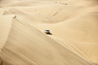 Africa, Namibia, Namib-Naukluft National Park, Namib desert, desert dunes, off-road vehicle - CVF00210