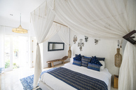 Cozy airy bedroom with blue pillows - SBOF01414