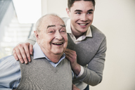 Portrait of happy senior man and young man - UUF12872