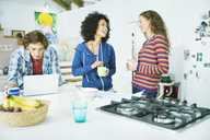Friends relaxing together in kitchen - CAIF03111