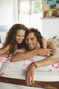 Couple relaxing together in bed - CAIF03123