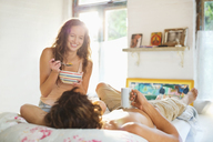 Couple having breakfast together in bed - CAIF03141