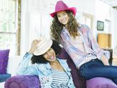 Women wearing colorful cowboy hats - CAIF03174