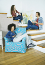 Friends relaxing together on steps - CAIF03216