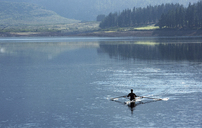 Man rowing scull on lake - CAIF03246