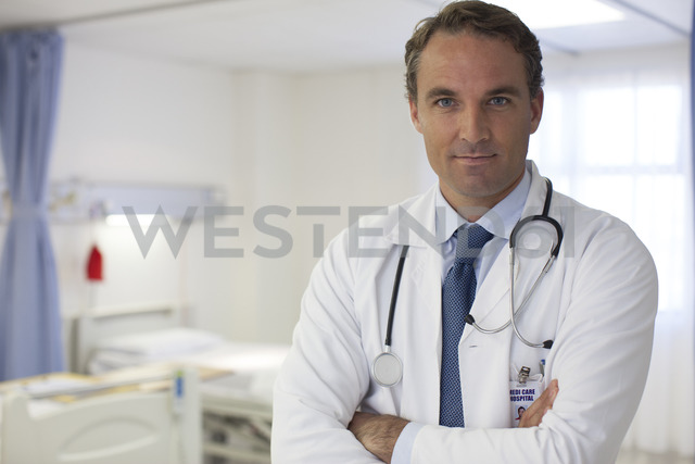 Doctor standing in hospital room - CAIF03282