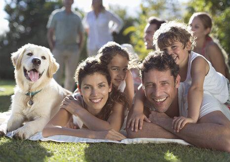 Family relaxing in backyard - CAIF03339