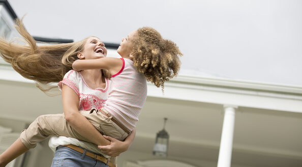Mother and daughter playing outdoors - CAIF03378