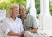 Older couple hugging on porch - CAIF03390